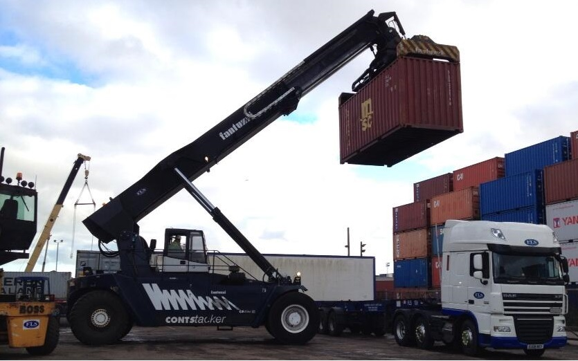 Container being lifted off a FLS branded truck